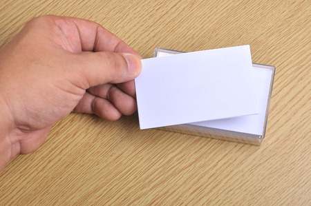 Hand hold blank mockup business card for branding and logo printing. Archivio Fotografico