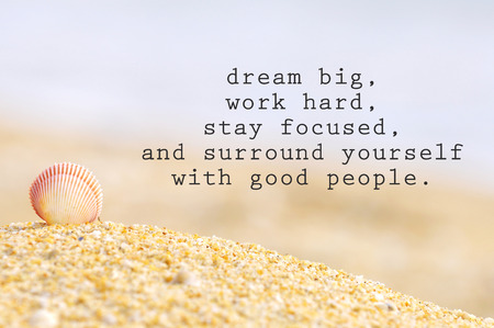 Inspirational motivating quote of shell clam on the sand at the beach. Dream big, work hard, stay focused, and surround yourself with good people. Stock Photo
