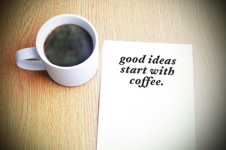 Inspirational motivating quote on paper with black coffee on the table. good ideas start with coffee.