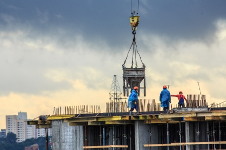 Pouring concrete into a newly built house