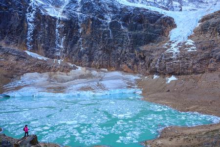 Angel Glacier and melt-water lake below Mount Edith Cavell, Jasper National Park, Alberta, Canada.