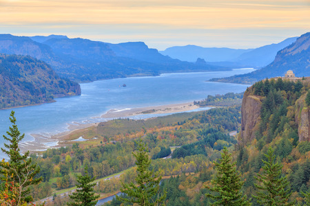cascade range: Crown Point and Vista House with rising sun over Columbia River Gorge.
