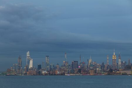 View of Manhattan skyline from New Jersey at sunset, New York City, USA
