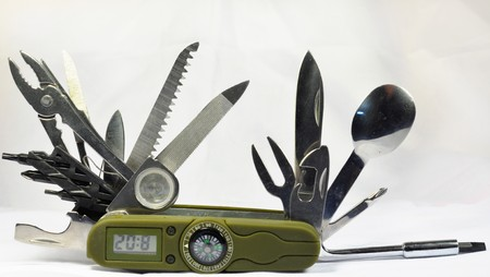 Knife with compass and clock