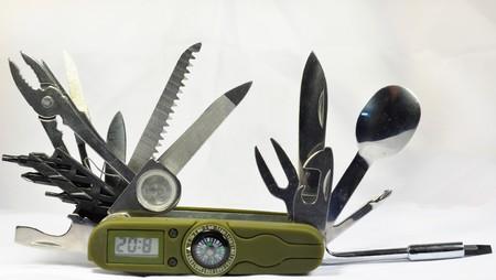 cuchillos: Cuchillo con br�jula y el reloj Foto de archivo