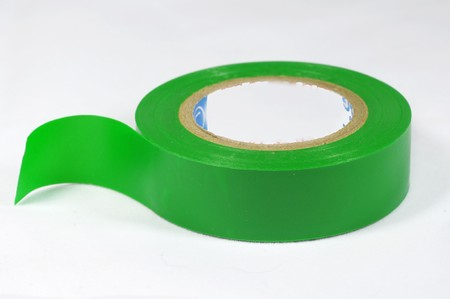 Rool of sticky green insulating Scotch tape on a white background Archivio Fotografico