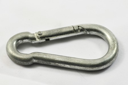 Metal aluminium Carabiner on a white backgroun Stock Photo