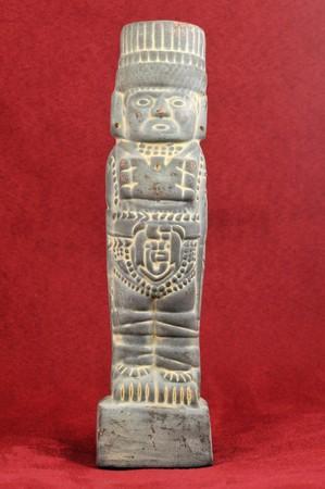 Ancient Mayan sculpture of an old Mayan god Stock Photo