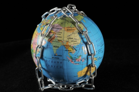 World in chains that represents the crisis on a black backgound