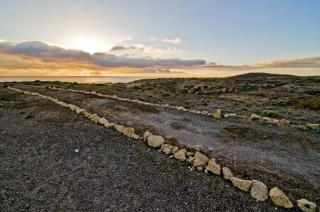 Pathway that conduce to the ocean, El Medano, Tenerife, Spain Stock Photo