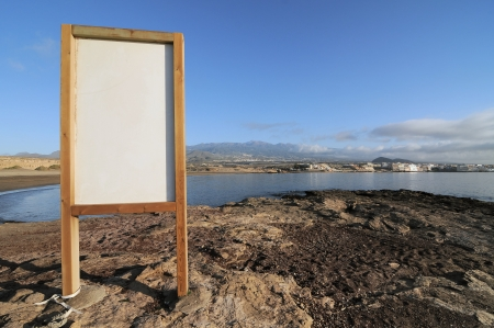 cartel: Cartel near the Atlantic ocean El Medano, Tenerife, Spain