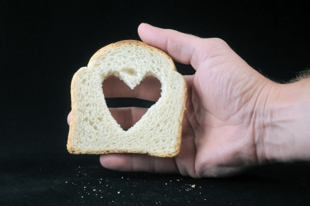darck: Bread with heart on a darck background Stock Photo
