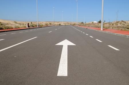 arrow on a asphalt street to the future,in Tenerife, Spain Stock Photo - 19187052