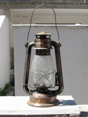 Old metal oil Lantern on a very sunny day