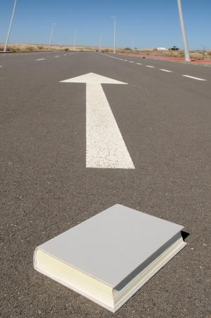 arrow on a asphalt street to the future Stock Photo