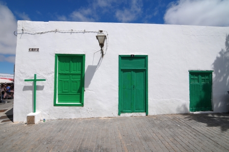 Old Church with green doors on a white wall,in Lanzarote , Spain