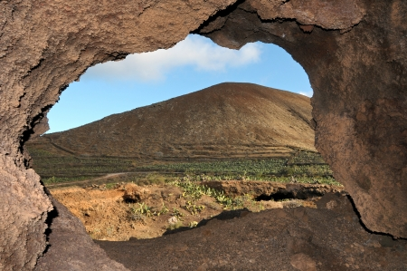 Cave near a volcano in the desert in spain Stock Photo