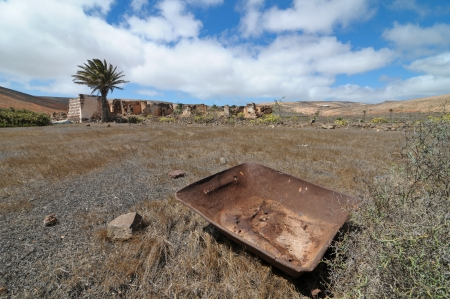 Rusty metal over a desert and a cloudy sky Stock Photo - 19830296