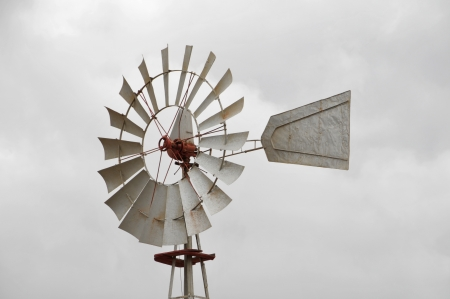 Metal windmill on a cloudy sky, in Canary Islands, Spain photo