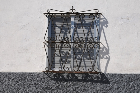 metal grate: window with metal grate on a colored wall Stock Photo