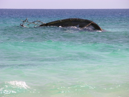sunken boat in the atlantic ocean in green cape photo