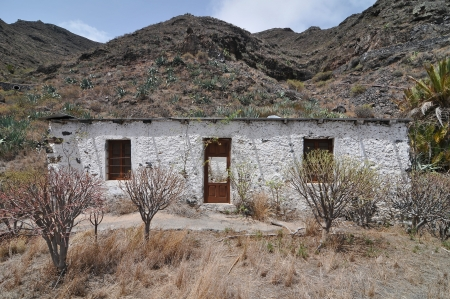Empty White Abandoned Building in the Desert , in Canary Islands, Spain photo