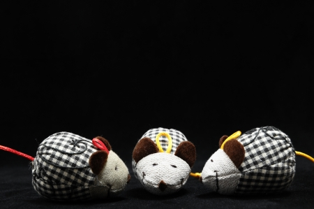 Toy Mouse Made of Cotton Cloth on a Black Background Stock Photo - 22211389