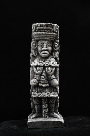 indian artifacts: One Ancient Mayan Statue on a Black Background