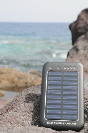 Portable Small Solar Panel near the Atlantic Ocean Stock Photo - 22211662