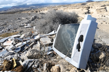 A Broken Gray Television Abandoned in the Desert photo