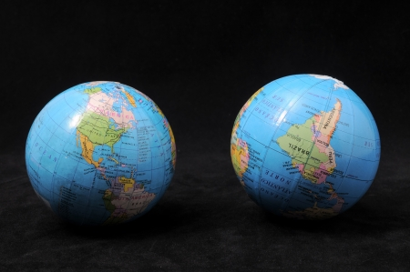Two Globes on a Dark Background - Time Concept Stock Photo - 22365863