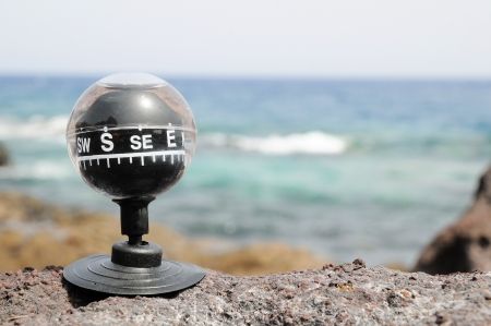 One Compass on the Rocks near the Atlantic Ocean Stock Photo - 22365961