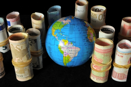 The Planet Earth and Rolled Money Financial Concept photo