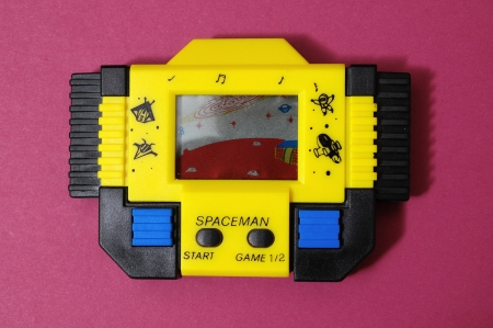 One Old Yellow Vintage Videogame with four Buttons 스톡 콘텐츠