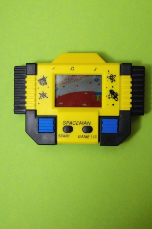 One Old Yellow Vintage Videogame with four Buttons photo