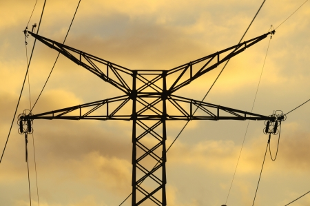 Power Electric Tower on a Cloudy Sky at Sunset photo