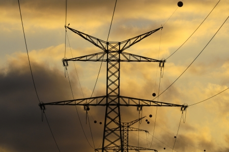 Power Electric Tower on a Cloudy Sky at Sunset