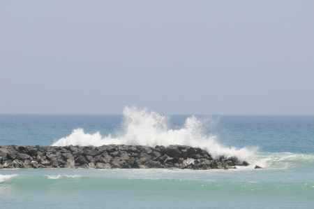 Waves over some Rocks  near the Atlantic Ocean photo
