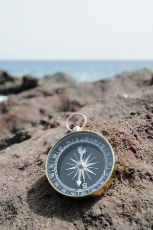 One Compass on the Rocks near the Atlantic Ocean photo