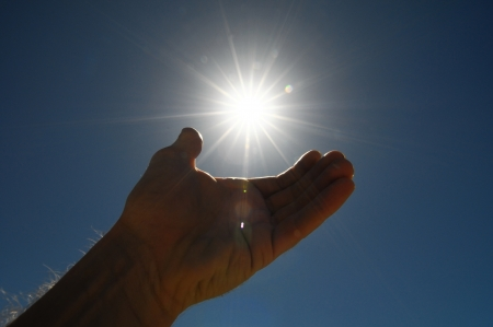 One Hand Catching the Sun Stars Stock Photo - 22485493