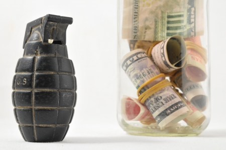 Money for War Concept Hand Grenade and Money Stock Photo - 22676551