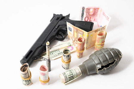 Money and Weapons Concept Weapons and Money on a White Background photo
