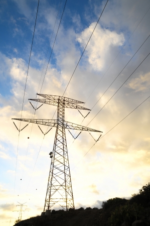 electric tower: Power Electric Tower on a Cloudy Sky at Sunset