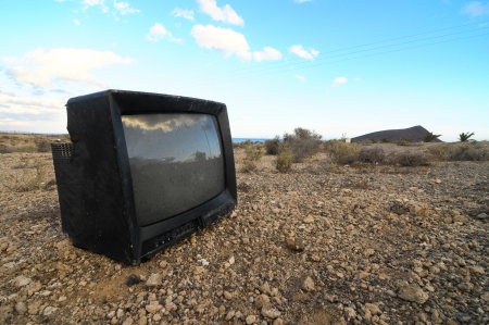A Broken Black Television Abandoned in the Desert Stock Photo - 22761059