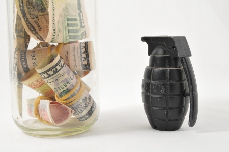 Money for War Concept Hand Grenade and Money Stock Photo - 22761154