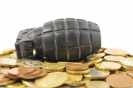 Money for War Concept Hand Grenade and Money