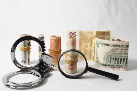 Tax Crime Concept Money and Handcuffs on a White Background 스톡 콘텐츠