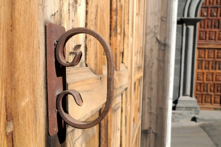 Old Rusty Handle on a Wooden Church Door Stock Photo - 22761734