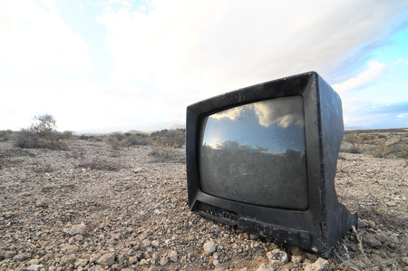 A Broken Black Television Abandoned in the Desert photo