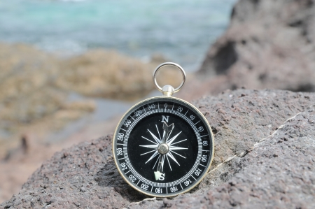 One Compass on the Rocks near the Atlantic Ocean Stock Photo - 22813261